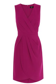 This sleeveless draped dress with crossover neckline flatters all shapes, with a cinched-in waist to create or accentuate an hourglass shape. Looks just as good at the office as it does on the dancefloor - add a furry jacket and towering heels for the office party.