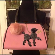 Cute Isabella Fiore Poodle Shoulder Bag Grease is the word. . .I'm a teacher, so this cute little bag is only used a few times a year on dress up days. In good condition overall with the following flaws: faint yellow spot on the front of the bag, scratches/discoloration on the latch, some light scratches to the leather.  please note: Pom Pom charm does not come with the bag. Isabella Fiore Bags Shoulder Bags