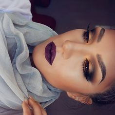 Dramatic copper smokey eye, winged eyeliner, and dark plum lip. Makeup perfection.