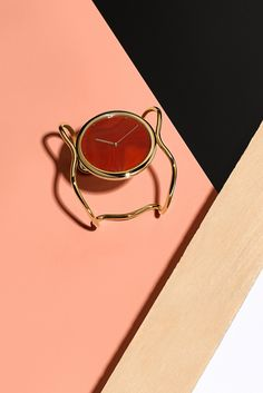 This bright orange Agate gemstone is the ultimate addition to Fossil x Opening Ceremony's fashion-forward Gold-Tone Stainless Steel Bangle Watch.