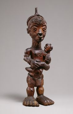 Africa | Maternity figure from the Luluwa people, DR Congo | Wood, metal ring | 19th - 20th century