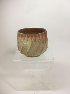 Faceted stoneware tea bowl, glaze on glaze, wood/soda fired. On my Etsy store.