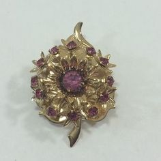 I just discovered this while shopping on Poshmark: Goldtone rhinestone brooch. Check it out!  Size: OS