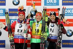 (L to R) Second place Tiril Eckhoff of Norway, first place Laura Dahlmeier of Germany and third place Anais Chevalier of France celebrate in the flower ceremony after the Woman 7.5km Sprint during the BMW IBU World Cup Biathlon 2017 - test event for PyeongChang 2018 Winter Olympic Games at Alpensia Biathlon Centre on March 2, 2017 in Pyeongchang-gun, South Korea.