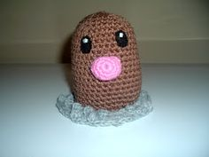 Diglett   Materials  Medium brown, grey and pink yarn  Black felt  H Hook  needle and thread   NOTE: I used a popcorn stitch to make the roc...