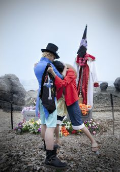 Sabo and Luffy. Ace's gravestone