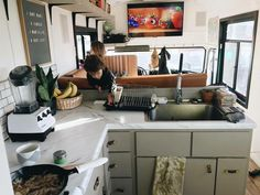 Tv mounted above the drivers seat... easy view of the living room while working in the kitchen.
