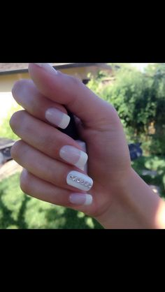 Gel nails French manicure for brides with Swarovski stones .