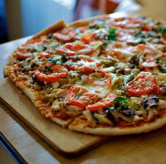 Whole-Wheat Veggie Pizza  Veggie pulp makes great pizza topping.  (Green peppers, bell peppers, spinach, basil)