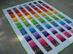"""Finished coin quilt top """"Lemonade"""" by FlossieBlossoms -- like the diagonal rainbow of color. would be easy to sew together all jelly roll color pieces (or at least lager chunks), cut, stagger and finish with background pieces"""