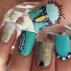 Feather themed glitter nail art in gold glitter and aquamarine polish finished with white and gold leaf details.