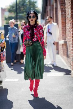 A guest wearing beret belt bag red blouse green maxi skirt sock boots is seen outside Gucci during Milan Fashion Week Spring/Summer 2018 on September...
