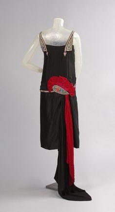 Circa 1925 Evening Dress designed and made by House of WORTH, Paris. Silk crepe-backed satin, silk velvet, glass beads, rhinestones, and sequins, via Philadelphia Museum of Art.