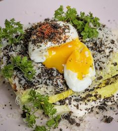 Caesar—creamy, anchovy-laced dressing, showers of cheese—plus smoked tomato, a runny egg, and a umami-packed black garlic crumble over top Garlic Uses, Runny Eggs, Black Garlic, Avocado Toast, Showers, Dressing, Cheese, Breakfast, Top