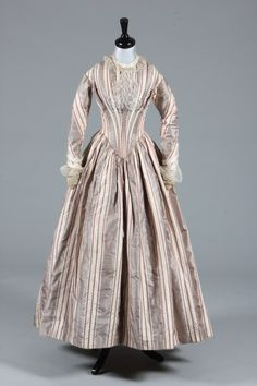 A fine striped taffeta bridal gown and bonnet, circa 1845, of grey and ivory silk with wine foliate stripes