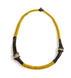 Silke Spitzer. Necklace: Between the Two my Heart is Balanced, 2012. Deer horn, yellow truck-canvas.