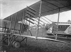 A Farman airplane with rockets attached to its struts.