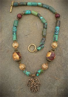 Turquoise and Bronze Hamsa Necklace by maggiezees on Etsy