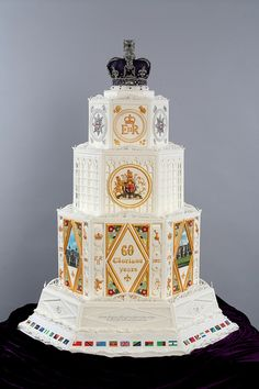 Her Majesty's Diamond Jubilee Cake--over 1 meter tall, used 50 kg of dried fruit soaked in whiskey and brandy. The top tier--the crown--is made of edible icing and (real) gems, and took 200 hours alone to make.