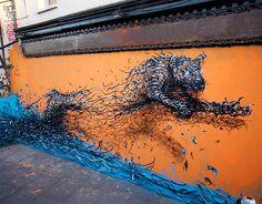 """Illusion: A year has gone by since I last looked at DALeast's street art. His """"creatures"""" as he calls it, are becoming more three-dimensional as he improves his shading technique. And the artist has had the opportunity to paint these """"wired"""" animals on building walls in England, United States, South Africa, France, and Switzerland. http://illusion.scene360.com/art/43303/wired-animals/"""