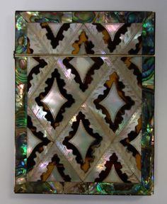 A 19th century calling card case. Diamond motif decorated with tortoiseshell, mother of pearl and abalone.