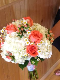 White hydrangea, coral movie star roses, peach hypericum and feverfew daisies - lovely for a backyard summer wedding!