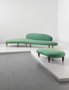 ISAMU NOGUCHI, An rare early Cloud-Form- sofa (model no. IN-70) and ottoman (model no. IN-71), c.1948. Material birch and fabric. Manufactured by The Herman Miller Furniture Company, USA. / Phillips
