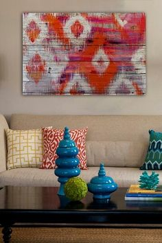 Colored living room ♥ LOVE the ikat wood work on wall!!