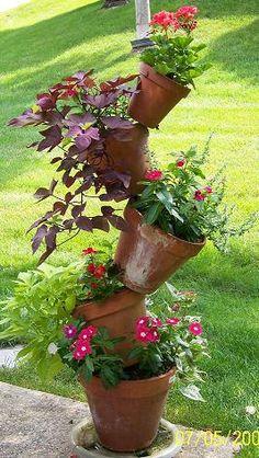 DIY Pot Planter - Easy to Make by placing a bar through bottom hole in pots - Garden Planters, Planter Pots, Unique Gardens, Dream Garden, Lawn And Garden, Herb Garden, Yard Art, Garden Projects, Garden Inspiration
