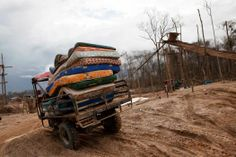 In this May 5, 2014 photo, a motortaxi delivers a cargo of mattresses to a #mining camp in La Pampa in Peru's Madre de Dios region. An estimated 20,000 wildcat miners toil in the malarial expanse of denuded #rainforest known as La Pampa, an area nearly three times the size of Washington, D.C