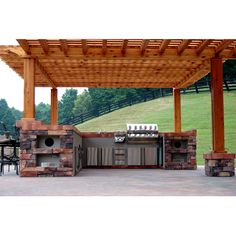 An Outdoor Kitchen & Grill Island Nestled Under a Gorgeous Wood Pergola