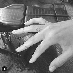 Cute tiny heart tattoo on finger