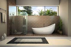 salle de bains zen avec baignoire design et tapis de sol avec effet cailloux