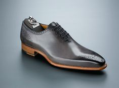 Carlos Santos Gray Medallion Shoe. If you want to see this shoe in our store or available online like it on Tomboy Tailors' Pinterest page. We are having shoes made down to U.S. Men's size 5 and will have Carlos Santos shoes online and in the store starting March 2014.  Available in U.S. Men's size 5 through 13. If you would like this shoe, drop us an email at mailto:shoes@tomb... and let us know your size and the shoe that you are interested in.#CarlosSantos #Gray Medallion #Shoe