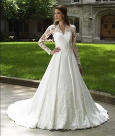 This long sleeve wedding gown has sheer lace sleeves.  The a-line style ball gown is flattering on many different shapes of brides. Designer #weddingdresses like this are quite affordable at Darius Cordell Fashion Ltd. Most of our custom bridal gowns are less than one thousand dollars.  Get pricing on our designs or on any other wedding dress pictures you have to see if we can make it for less than the original.