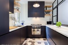 Stylish: This Italian kitchen has a very simple style with dark blue cabinets, geometric t...