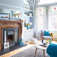 Blue light-filled living room with centrepiece fireplace After living room ideas? This pale blue scheme is cool, smart and stylish Cozy Living Rooms, Home Living Room, Living Room Furniture, Living Room Decor, Living Room Ideas Light Blue, Light Blue Rooms, Blue Lounge, Living Room Color Schemes, Living Room Designs