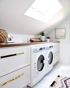 LOVE this! Maximized space in old Bathroom by adding extra storage and a washer & dryer under the angled eaves... and it looks beautiful! #bathroomgoals