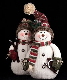 These whimsical snowmen figurines add a touch of homespun appeal to your holiday décor.