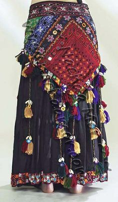 American Tribal Style® (ATS®) belly dance embroidered hip scarf with beads and shisha mirrors on a sturdy black cotton base. Cascading tassel strands with cowry and shisha decorations. Unique designs in assorted colors.