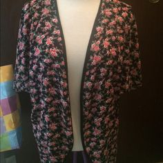 Thin floral cardigan L/XL thin short sleeve floral cardigan. New without tags Deb Sweaters Shrugs & Ponchos