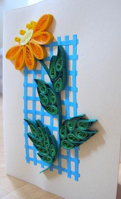 Quilled flower on a trellis