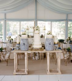 Wedding cake display with a whitewashed wooden table and blue and white chinoiserie. Event design and florals by Lauren Chitwood Events, image by Bella Grace Studios.