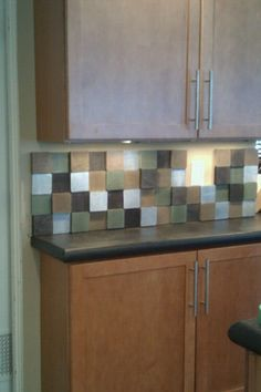 DIY kitchen backsplash made from painted scrap lumber 4x4s!