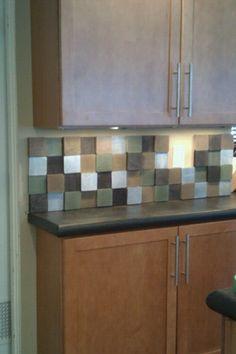 DIY kitchen backsplash made from painted scrap lumber 4x4s!