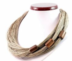 Proved necklace made of high and smooth to the touch linen yarn. The pride are either fixed beads. Corals are made of ebony wood. Size of about 20 mm. Necklace length approximately 47-50 cm....