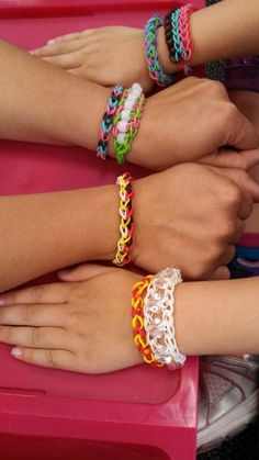 Rainbow Loom bracelets made with the addition of beads, following The Bead Ladder pattern.