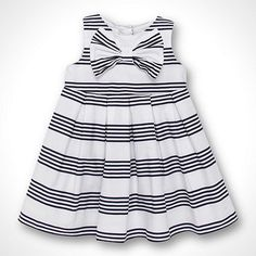 Designer baby's navy striped dress. A nautical cute outfit for baby.