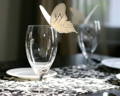 Paper butterflies on cups