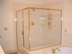 Enclosed Showers glass enclosed shower with neutral tile work. i like, but add the